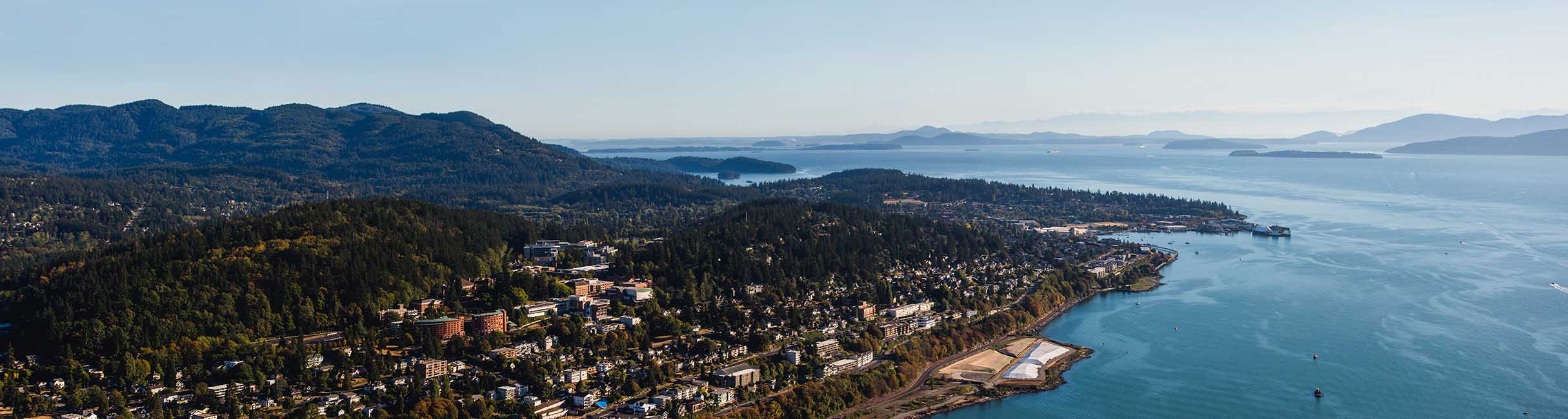 Bellingham Bay coastline with hills covered in trees and buildings